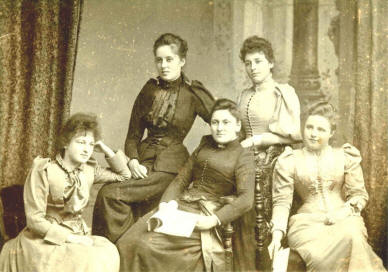 group of victorian girls posed in studio